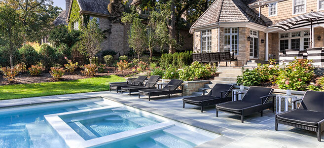 relaxed atmosphere of this poolscape extends the inground pool space